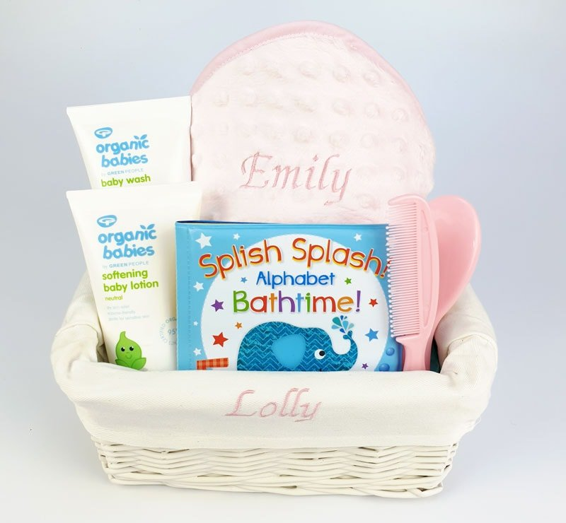 Personalised pink bath time gift basket including hooded towel, waterproof book, brush & comb, baby wash and shampoo and baby lotion